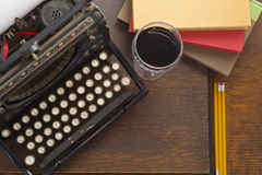 typewriter-wine-books-old-vintage-glass-pencils-retro-creative-writing-relazation-themed-desk-top-62558750